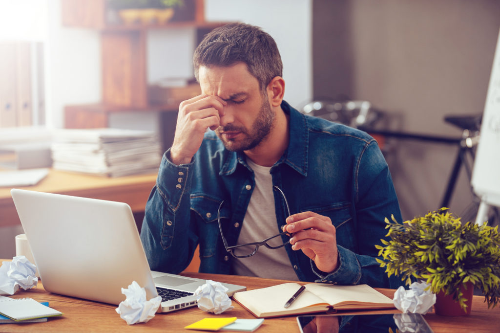 man needs chiropractic care for his migraine